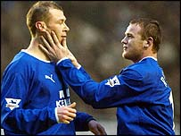 Everton striker Duncan Ferguson is congratulated by team-mate Wayne Rooney after scoring his first goal