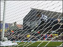 Heidar Helguson's header hits the bar and drops onto the goalline