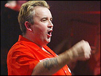 Phil Taylor celebrates taking a set against Wayne Mardle