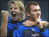 Danny Spiller (left) helps Tommy Johnson celebrate his goal