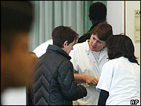 A relative is comforted at a crisis centre in an hotel near Roissy Charles de Gaulle airport