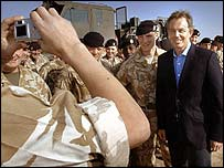 Tony Blair smiles for pictures with troops in Basra