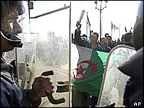 Algerian riot police guard the parliament building