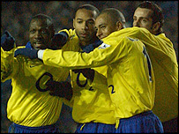Arsenal celebrate Thierry Henry's brilliant equaliser