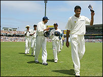 Anil Kumble leads his team-mates off the SCG