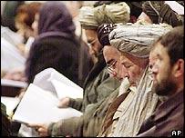 Loya Jirga delegates read copy of new constitution