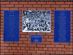 Plaques at foot of statue
