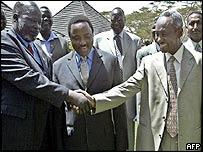 SPLA leader John Garang (L) and Vice President Ali Osman Taha