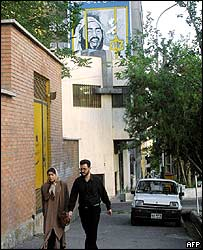Iranian couple walk along Khaled Eslamboli Avenue