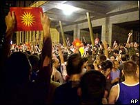 Protesters in Macedonia wave the Vergina Star, which used to be at the centre of the original Macedonian flag