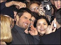Tom Cruise moves among the autograph hunters