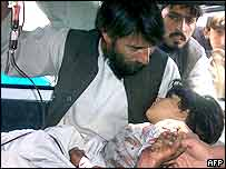 An injured Afghan child receives medical attention