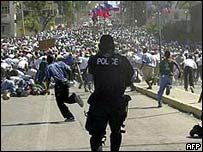 Police fire to disperse demonstrators on 1 January 2004
