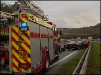 Crashed car and fire engine on A38