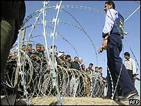 Crowds gather outside Abu Ghraib prison