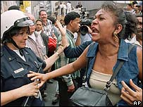 Crowds protest against President Hugo Chavez