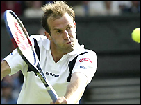 Greg Rusedski in action at Wimbledon