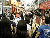 Street of shoppers in Japan