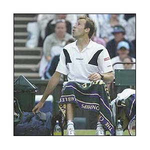 Rusedski argues with the umpire at Wimbledon 2003