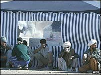 Iranian men in front of a tent in Bam