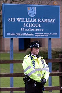 Police kept watch outside the school