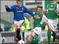 Chris Burke is tackled by Kevin Thomson