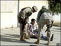 File photos of US soldiers helping an injured Iraqi in Kirkuk