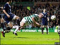 John Hartson heads home Celtic's first goal