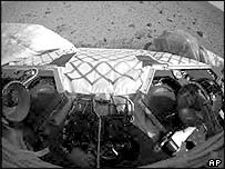 Image of Spirit rover on Mars with front wheels locked in place