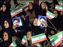 Iranian girls wave flags and portraits of President Khatami during a rally for the 2000 parliamentary elections
