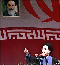 Iranian President Mohammad Khatami gestures under a picture of Iran's late revolution founder Ayatollah Khomeini