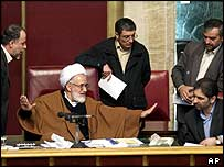 Iran's Parliament Speaking Mehdi Karoubi (centre) tries to calm the protests
