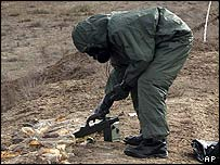 Danish soldier inspecting suspected chemical weapons in Iraq