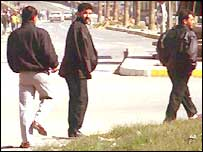 Young men loitering on Baghdad street corner