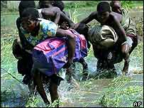 Mozambicans wade through floods   AP