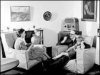 Family listening to the wireless in 1947, BBC