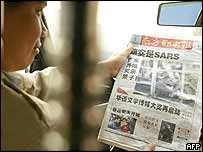 Taxi driver reading Southern Metropolis Newspaper