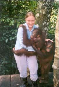 Abigail Dymond with orang-utans
