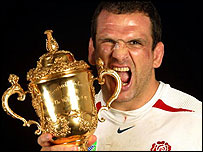 Martin Johnson celebrates with the World Cup trophy