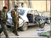 Iraqi police at scene of a blast outside a mosque in Baquba, 9 January, 2004