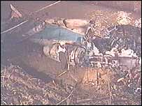 The wreckage of the crashed plane in a canal
