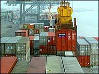 Containers being loaded on to a ship's deck 
