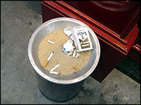 Cigarette butts outside a bar on 42nd Street