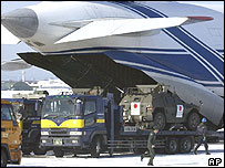 Japan Ground Self Defence Force heavy equipment is loaded into a chartered Russian cargo plane
