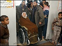 Sheik Ahmed Yassin is pushed in his wheelchair by bodyguards as he arrives for prayers at a mosque in Gaza City on Friday 16 January 2004