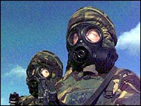 Troops in hazard masks   PA