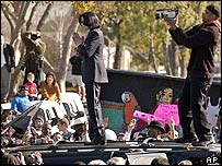 Michael Jackson on the roof of his car after his arraignment in January 2004