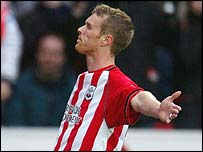 Brett Ormerod celebrates the opening goal