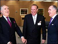 David and Frederick Barclay flank Andrew Neil
