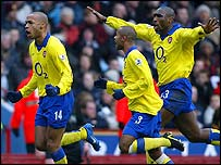 Arsenal striker Thierry Henry is congratulated by Ashley Cole and Sol Campbell